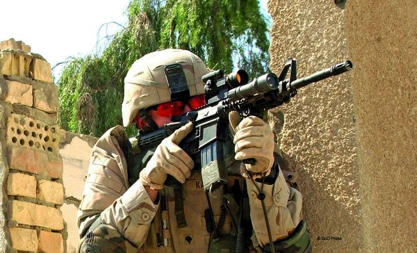 Aimpoint CompM3 reflex sight on M4 carbine