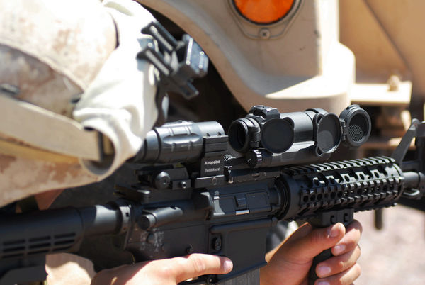Aimpoint CompM4s and magnifier on M4 carbine